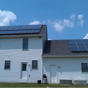 Back of a house with solar panels on roof