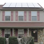 House with solar panels on front side of roof