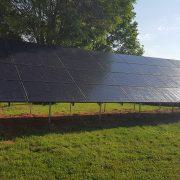 Group of solar panels near farm