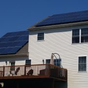 House in neighborhood with solar panels on roof