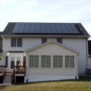 Back of a house with solar panels on its roof