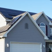 Solar panels on the roof of a house and garage