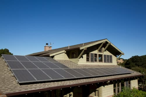 Solar panels installed on roof shingles of residential property
