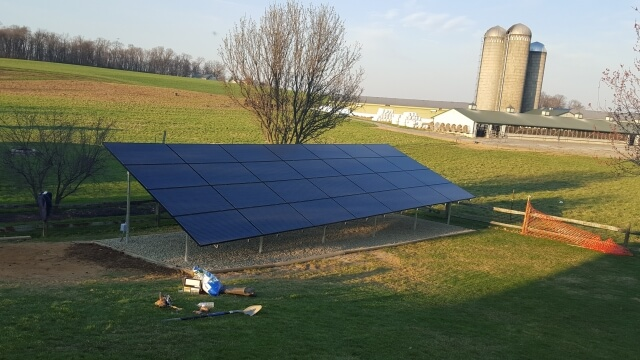 ground mounted solar panels in a rural back yard
