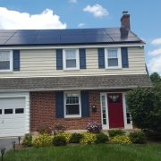 Two story house with roof covered by solar panels