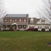 Two story home with solar panels on roof