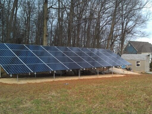 Group of solar panels next to a house